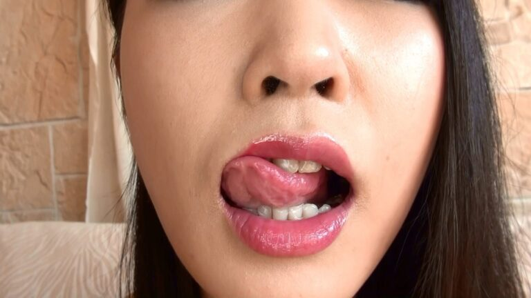 Fetish pics of a Japanese woman sticking out her tongue