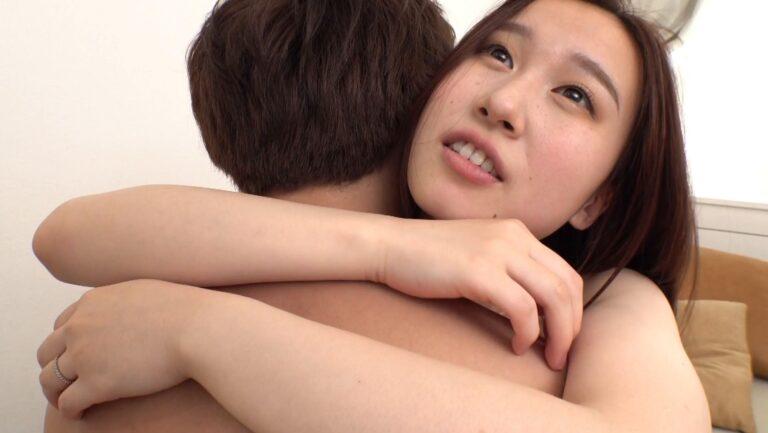 Porn pics of Japanese pornstar Kokona hugging a man